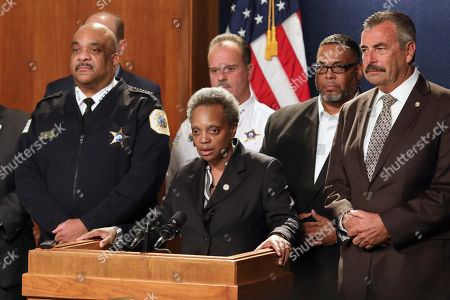 Chicago Mayor Lori Lightfoot, center, has named former Los Angeles police Chief Charlie Beck, right, to be Chicago's interim police superintendent on in Chicago. The announcement comes a day after Superintendent Eddie Johnson, left, announced his retirement after more than three years as the city's police chief and more than 30 years with the department