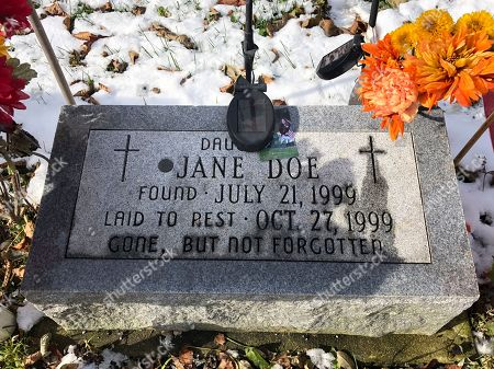 This photo from Caledonia, Wis. shows the grave of Jane Doe who has been identified as Peggy Lynn Johnson. Racine County Sheriff Christopher Schmaling says Linda La Roche, of McHenry, Ill., has been charged with first-degree intentional homicide and hiding a corpse in the killing of Johnson