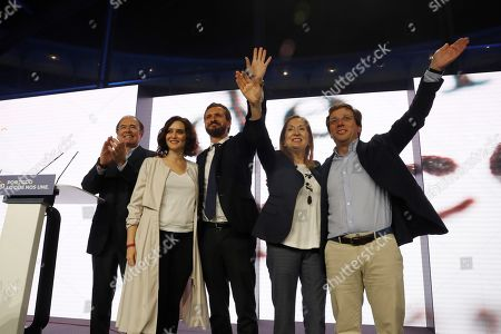 Stock Photo of Spanish leader of People's Party (PP) and Prime Minister candidate Pablo Casado (C), PP's candidate to the Congress of Deputies for Madrid Ana Pastor (2-R), Madrid's regional President Isabel Diaz Ayuso (2-L), Madrid's Mayor Jose Luis Martinez Almeida (R) and party member Pio Garcia Escudero (L) attend the party's last electoral campaign rally at Las Ventas bullring in Madrid, Spain, 08 November 2019. Spain will be holding general elections on 10 November 2019.