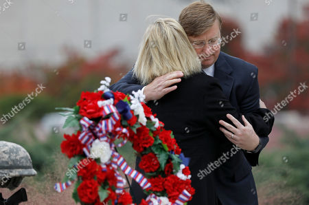 Stock Picture of Jenny Smith, Tate Reeves. Republican Gov.-elect Tate Reeves, hugs Jenny Smith, a Gold Star mother, following a Veterans Day ceremony at the Museum of Mississippi History and Mississippi Civil Rights Museum in Jackson, Miss., . Smith and her husband Eddie Smith, lay a memorial wreath on Entergy Plaza outside the museums, honoring all veterans and her late son, Marine Staff Sgt. Jason A. Rogers, who was killed in an explosion two days before what would have been his 29th birthday, in April 7, 2011