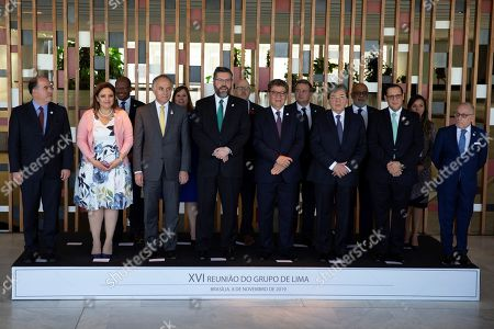 The foreign ministers attending the meeting of The Lima Group pose for the official photo in Brasilia, Brazil, 08 November 2019. From left to right Venezuela's minister of Foreign affairs designated by the President of the National Assembly (AN) of Venezuela Juan Guaido, Julio Borges (Venezuela), ministers of foreign affairs, Sandra Erica Jovel Polanco (Guatemala), Teodoro Ribera Neumann (Chile ), Ernesto Araujo (Brasil), Gustavo Meza-Quadra (Peru), Carlos Holmes Trujilo García (Colombia), Lizandro Rosales Banedas (Honduras), Jorge Marcelo Faurie (Argentina).