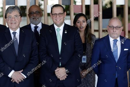 Stock Picture of Carlos Holmes, Lizandro Rosales Banedas, Jorge Marcelo Faurie. Colombia's Foreign Minister Carlos Holmes, from left, Honduras' Foreign Minister Lizandro Rosales and Argentina's Foreign Minister Jorge Faurie, pose for a group photo during the 16th meeting of the Lima Group, in Brasilia, Brazil