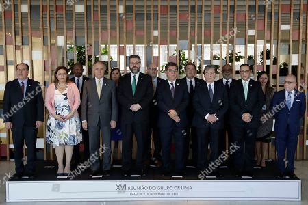 Julio Borges, Erica Jovel Polanco, Teodoro Ribera Neumann, Ernesto Araujo, Gustavo Meza-Quadra, Carlos Holmes, Lizandro Rosales Banedas, Jorge Marcelo Faurie. Participants of the 16th meeting of the Lima Group pose for a group photo at the Itamaraty Palace, in Brasilia, Brazil, . Pictured are Julio Borges, foreign policy advisor for Juan Guaido, Venezuela's self-proclaimed president, from left to right, front row, Guatemala's Foreign Minister Erica Jovel Polanco, Chile's Foreign Minister Teodoro Ribera, Brazil's Foreign Minister Ernesto Araujo, Peru's Foreign Minister Gustavo Meza-Cuadra, Colombia's Foreign Minister Carlos Holmes, Honduras Foreign Minister Lizandro Rosales, and Argentina's Foreign Minister Jorge Faurie