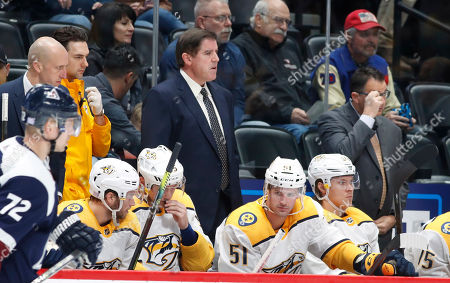 R m. Nashville Predators head coach Peter Laviolette in the second period of an NHL hockey game, in Denver