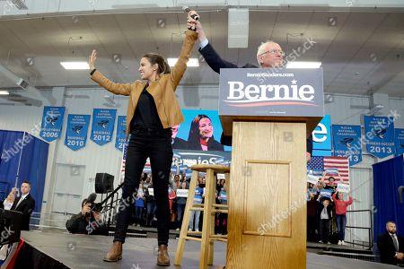 Bernie Sanders, Alexandria Ocasio-Cortez. Democratic presidential candidate Sen. Bernie Sanders, I-Vt., and Rep. Alexandria Ocasio-Cortez, D-N.Y., stand on stage on the campus of Iowa Western Community College in Council Bluffs, Iowa