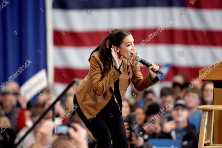 Stock Image of Rep. Alexandria Ocasio-Cortez, D-N.Y. works the crowd during an election rally with Democratic presidential candidate Sen. Bernie Sanders, I-Vt., on the campus of Iowa Western Community College in Council Bluffs, Iowa