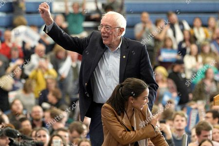Stock Picture of Bernie Sanders, Alexandria Ocasio-Cortez. Democratic presidential candidate Sen. Bernie Sanders, I-Vt.,and Rep. Alexandria Ocasio-Cortez, D-N.Y., wave to supporters following an election rally on the campus of Iowa Western Community College in Council Bluffs, Iowa