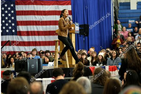 Rep. Alexandria Ocasio-Cortez, D-N.Y. addresses supporters during an election rally with Democratic presidential candidate Sen. Bernie Sanders, I-Vt., on the campus of Iowa Western Community College in Council Bluffs, Iowa