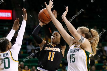 Juicy Landrum, Lauren Cox, Ariel Williams. Baylor's Juicy Landrum (20) and Lauren Cox (15) defend as Grambling State guard Ariel Williams (11) shoots in the first half of an NCAA college basketball game in Waco, Texas
