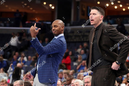 Memphis head coach Penny Hardaway calls to a player in the first half of an NCAA college basketball game against UIC, in Memphis, Tenn
