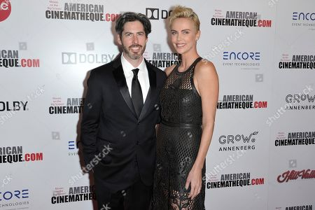 Jason Reitman, Charlize Theron. Jason Reitman, left, and Charlize Theron arrive at the 33rd American Cinematheque Award in Theron's honor at the Beverly Hilton Hotel, in Beverly Hills, Calif