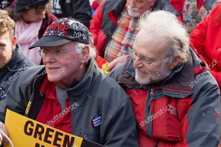 Ben Cohen and Jerry Greenfield, of 'Ben and Jerry's' Ice Cream, participates in a climate protest.