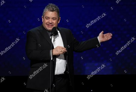Stock Photo of Patton Oswalt speaks at the 33rd American Cinematheque Award honoring Charlize Theron at the Beverly Hilton Hotel, in Beverly Hills, Calif