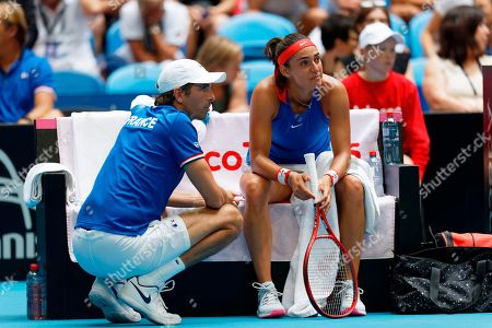 French captain Julien Benneteau, left, consoles Caroline Garcia as she suffered a heavy defeat by Australia's Ash Barty during their Fed Cup tennis final in Perth, Australia