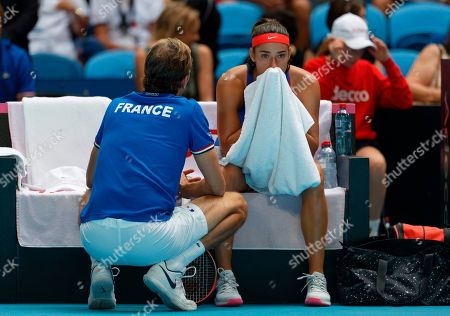 Julien Benneteau Caroline Garcia. French Captain Julien Benneteau consoles Caroline Garcia as she suffered a defeat by Australia's Ash Barty during their Fed Cup tennis final in Perth, Australia