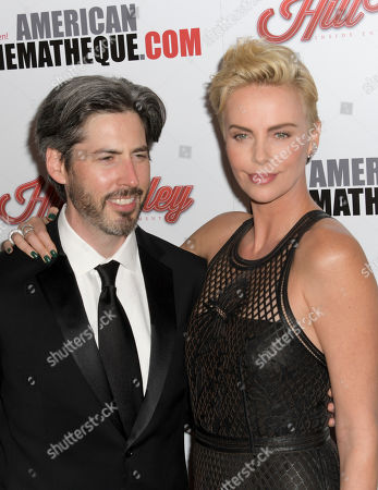 Charlize Theron (R) poses with Canadian film director Jason Reitman (L) upon their arrival for the American Cinematheque 2019 Award Show at the Beverly Hilton in Los Angeles, California, USA, 08 November 2019.