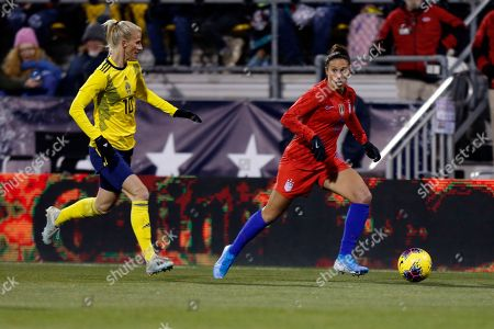 United States forward Carli Lloyd, right, controls the ball in front of Sweden forward Sofia Jakobsson during a women's international friendly soccer match in Columbus, Ohio, . United States won 3-2