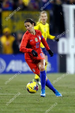 United States forward Carli Lloyd, left, controls the ball in front of Sweden defender Nathalie Bjorn during a women's international friendly soccer match in Columbus, Ohio, . United States won 3-2