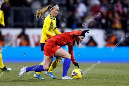 United States midfielder Andi Sullivan, right, falls in front of Sweden midfielder Kosovare Asllani during a women's international friendly soccer match in Columbus, Ohio, . United States won 3-2