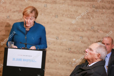 German Chancellor Angela Merkel speaks during a prayer in the Chapel of Reconciliation for the celebrations of the 30th anniversary of the fall of the Berlin Wall at the Berlin Wall Memorial site along Bernauer street in Berlin, Germany, 09 November 2019. The fall of the Berlin Wall led to the collapse of the communist East German GDR government in 1989 and the eventual reunification of East and West Germany. At right sits President of German Bundestag Wolfgang Schaeuble.