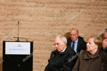 German Chancellor Angela Merkel attends a prayer in the Chapel of Reconciliation for the celebrations of the 30th anniversary of the fall of the Berlin Wall at the Berlin Wall Memorial site along Bernauer street in Berlin, Germany, 09 November 2019. The fall of the Berlin Wall led to the collapse of the communist East German GDR government in 1989 and the eventual reunification of East and West Germany. At left sits President of German Bundestag Wolfgang Schaeuble.