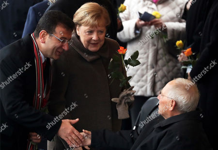 Istanbul mayor Ekrem Imamoglu (L) German Chancellor Angela Merkel (C) and the president of the German Parliament Bundestag Wolfgang Schaeuble (R) attend the celebrations of the 30th anniversary of the fall of the Berlin Wall at the Berlin Wall Memorial site along Bernauer street in Berlin, Germany, 09 November 2019. The fall of the Berlin Wall led to the collapse of the communist East German GDR government in 1989 and the eventual reunification of East and West Germany.