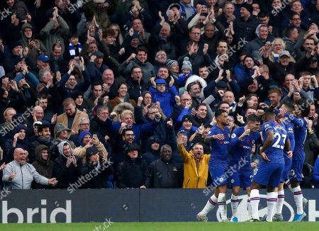 Chelsea's Christian Pulisic celebrates with teammates after scoring his sides second goal during their English Premier League soccer match between Chelsea and Crystal Palace at Stamford Bridge stadium in London