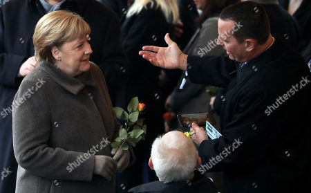 Stock Picture of German Chancellor Angela Merkel (L), US Ambassador to Germany Richard Allen Grenell (R) and the president of the German Parliament Bundestag Wolfgang Schaeuble (C) attends the celebrations of the 30th anniversary of the fall of the Berlin Wall at the Berlin Wall Memorial site along Bernauer street in Berlin, Germany, 09 November 2019. The fall of the Berlin Wall led to the collapse of the communist East German GDR government in 1989 and the eventual reunification of East and West Germany.