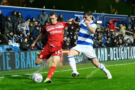 Jonathan Howson (16) of Middlesbrough battles for possession with Ryan Manning (14) of Queens Park Rangers during the EFL Sky Bet Championship match between Queens Park Rangers and Middlesbrough at the Kiyan Prince Foundation Stadium, London