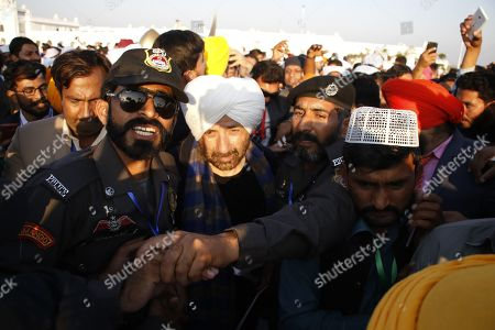 Sunny Deol (C) an Indian celebrity visits the Shrine of Baba Guru Nanak at Gurduwara Darbar Sahib during the opening of the Kartarpur Corridor, in Kartarpur, Pakistan, 09 November 2019. The Kartarpur Corridor enables the first visa-free border crossing between India and Pakistan, a corridor that will allow Sikh pilgrims to easily visit the shrine at Kartarpur in Pakistan which is related to Guru Nanak, the first Sikh Guru or Master. The corridor which had been a long pending demand of Sikh community, known as the Kartarpur corridor is a rare sign of cooperation between the two nuclear-armed rival countries.