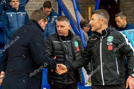 Hibernian FC caretaker manager, Eddie May shakes hands with Tommy Wright, manager of St Johnstone FC before the Ladbrokes Scottish Premiership match between St Johnstone FC and Hibernian FC at McDiarmid Park, Perth