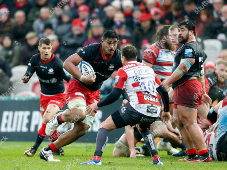 Stock Image of Will Skelton of Saracens crashes past Danny Cipriani of Gloucester