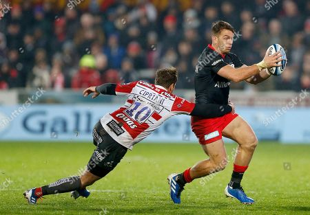 Alex Lewington of Saracens is tackled by Danny Cipriani of Gloucester