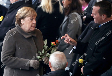 German Chancellor Angela Merkel (L), US Ambassador to Germany Richard Allen Grenell (R) and the president of the German Parliament Bundestag Wolfgang Schaeuble (C) attends the celebrations of the 30th anniversary of the fall of the Berlin Wall at the Berlin Wall Memorial site along Bernauer street in Berlin, Germany, 09 November 2019. The fall of the Berlin Wall led to the collapse of the communist East German GDR government in 1989 and the eventual reunification of East and West Germany.