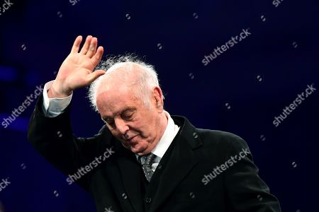 Conductor Daniel Barenboim greets audience during the celebrations of the 30th anniversary of the fall of the Berlin Wall at the Brandenburg Gate in Berlin, Germany, 09 November 2019. The fall of the Berlin Wall led to the collapse of the communist East German GDR government in 1989 and the eventual reunification of East and West Germany.