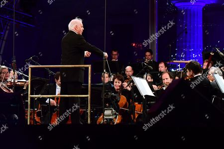 State Chapels Berlin conducted by Daniel Barenboim perform during the celebrations of the 30th anniversary of the fall of the Berlin Wall at the Brandenburg Gate in Berlin, Germany, 09 November 2019. The fall of the Berlin Wall led to the collapse of the communist East German GDR government in 1989 and the eventual reunification of East and West Germany.