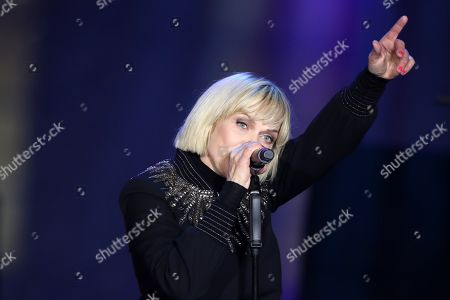 German singer and actress Anna Loos performs during the celebrations of the 30th anniversary of the fall of the Berlin Wall at the Brandenburg Gate in Berlin, Germany, 09 November 2019. The fall of the Berlin Wall led to the collapse of the communist East German GDR government in 1989 and the eventual reunification of East and West Germany.