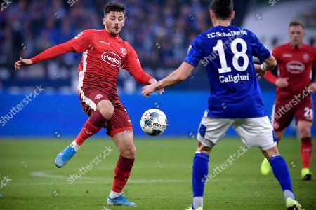 Duesseldorf's Dawid Kownacki (L) in action against Schalke's Daniel Caligiuri (R) during the German Bundesliga soccer match between FC Schalke 04 and  Fortuna Duesseldorf in Gelsenkirchen, Germany, 09 November 2019.