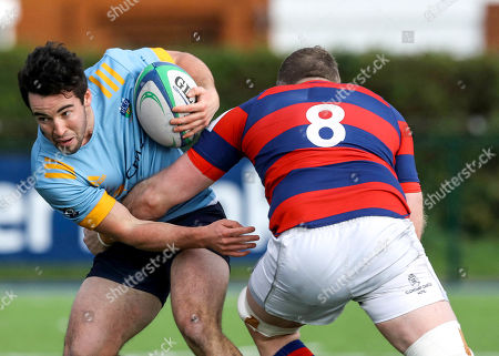 Stock Image of Clontarf vs UCD. Clontarf's Michael Noone and Jack Patterson of UCD