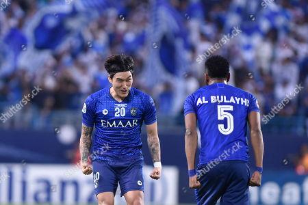 Al Hilal's Jang Hyun-Soo, left, and Al Hilal's Ali Al Bulayhi celebrate end of the AFC Champions League final soccer match between Al Hilal and Urawa Red at King Fahd stadium in Riyadh, Saudi Arabia, . Al Hilal won 1-0