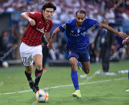 Stock Picture of Urawa Reds' Daiki Hashioka, left, fights for the ball with Al Hilal's Abdullah Otayf during the AFC Champions League final soccer match between Al Hilal and Urawa Red at King Fahd stadium in Riyadh, Saudi Arabia, . Al Hilal won 1-0