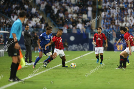 Al-Hilal player Andre Carrillo (L) in action against Urawa Red Diamonds player FABRICIO (R) during the AFC Champions League final First leg match between Al-Hilal and Urawa Red Diamonds at King Saud University Stadium, Al-Riyadh, Saudi Arabia, 09 November 2019.