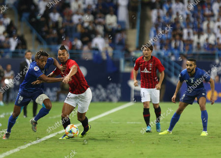 Stock Photo of Al-Hilal player Andre Carrillo (L) in action against Urawa Red Diamonds player FABRICIO (R) during the AFC Champions League final First leg match between Al-Hilal and Urawa Red Diamonds at King Saud University Stadium, Al-Riyadh, Saudi Arabia, 09 November 2019.