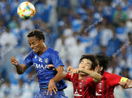 Al-Hilal player Andre Carrillo (L) in action against Urawa Red Diamonds player KOROKI (C) And Urawa Red Diamonds player Tomoaki Makino (R) during the AFC Champions League final First leg match between Al-Hilal and Urawa Red Diamonds at King Saud University Stadium, Al-Riyadh, Saudi Arabia, 09 November 2019.