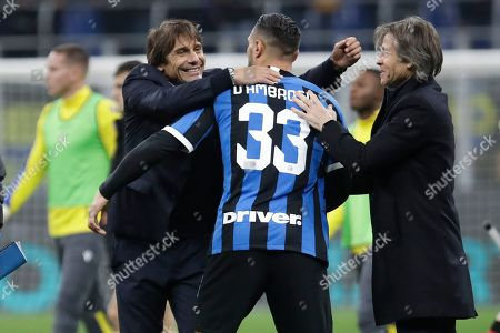 Inter Milan's head coach Antonio Conte, left, celebrates with Danilo D'Ambrosio, center, and team manager Gabriele Oriali at the end of the Serie A soccer match between Inter Milan and Hellas Verona, at the San Siro stadium in Milan, Italy, . Inter won 2-1