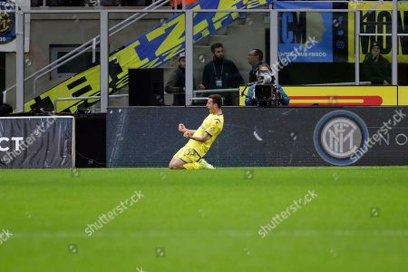 Verona's Valerio Verre celebrates after scoring his side's opening goal during the Serie A soccer match between Inter Milan and Hellas Verona, at the San Siro stadium in Milan, Italy