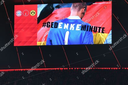 A display informs about a minute of memorial in honor of german goalkeeper Robert Enke, who comitted suicide due to a severe depression in 2009, during the German Bundesliga soccer match between FC Bayern and Borussia Dortmund in Munich, Germany, 09 November 2019.