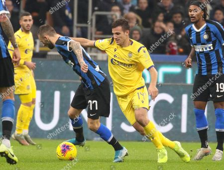 Inter's Marcelo Brozovic (3L) and Hellas Verona's Valerio Verre (2R) in action during the Italian Serie A soccer match FC Inter vs Hellas Verona at the  Giuseppe Meazza Stadium in Milan, Italy 9 November 2019.