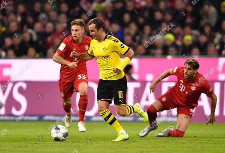 Bayern's Joshua Kimmich (L), Dortmund's Mario Goetze (C) and Bayern's Javi Martinez (R) in action during the German Bundesliga soccer match between FC Bayern Munich and Borussia Dortmund in Munich, Germany, 09 November 2019.