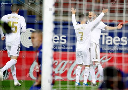 Real Madrid's French striker Karim Benzema (R) celebrates with Eden Hazard (2-R) after scoring the opening goal against SD Eibar during their Spanish LaLiga Primera Division soccer match played at the Ipurua stadium in Eibar, northern Spain, 09 November 2019.